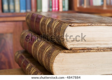 Old books at the library - stock photo