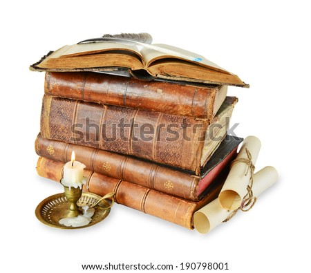 Old books, candle in candlestick, featherand scroll on a white background - stock photo