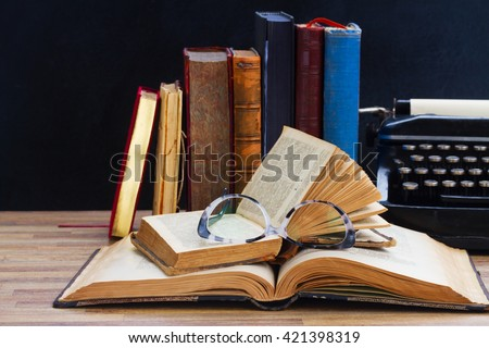 Old books, glasses  and typewriter   - writting and publishing  concept  - stock photo
