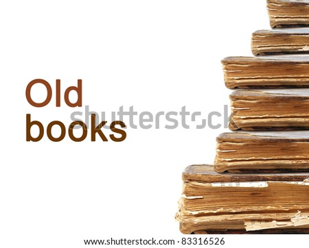 Old books in a row isolated on white - stock photo