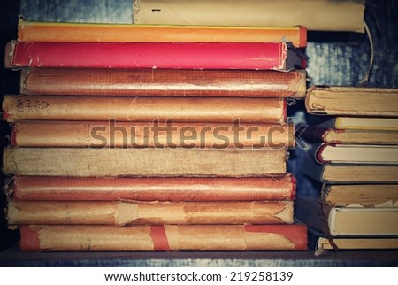 Old books in library. Retro and antique style - stock photo