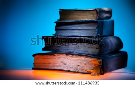Old books, mystical blue light  background - stock photo