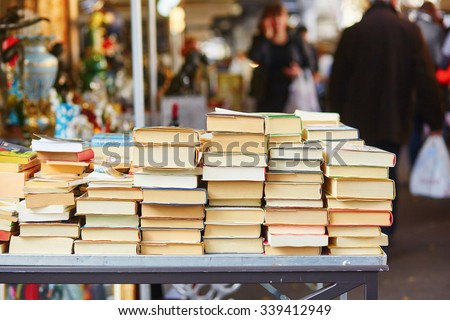 Old books on a Parisian flea market - stock photo