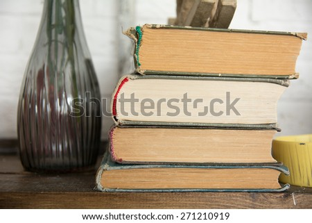 Old books on a shelf in a cottage. Background of the books - stock photo