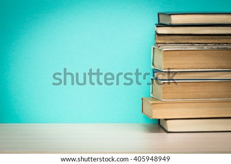 Old books on a wooden shelf