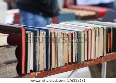 Old books on market - stock photo