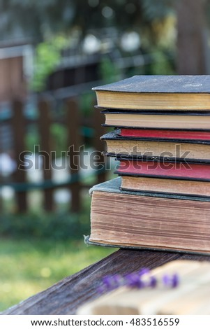 Old books on nature background
