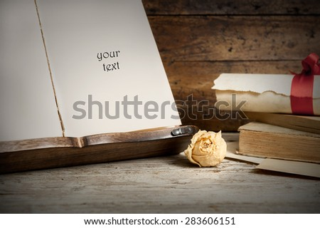 old books on old wood in retro style - stock photo
