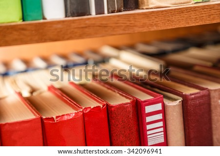 Old books on shelf in the Library - stock photo