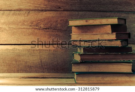 Old books on the wooden floor - stock photo