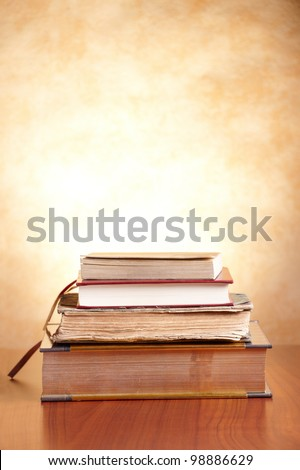 Old books on the wooden table - stock photo