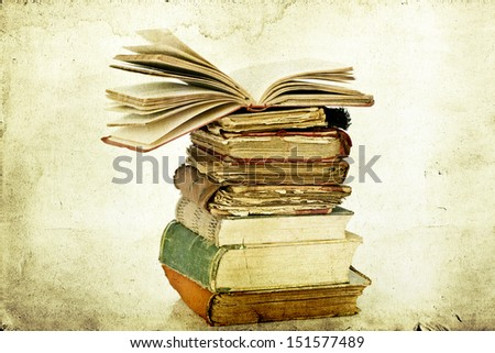 Old books on vintage background - stock photo