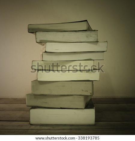 Old books on wooden planks