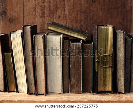 old books on wooden shelf.  - stock photo