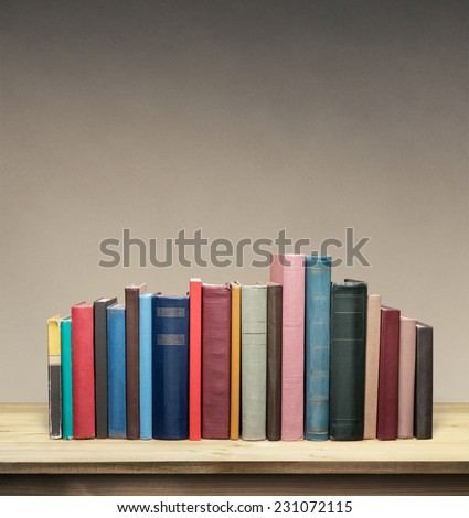 Old books on wooden table - stock photo