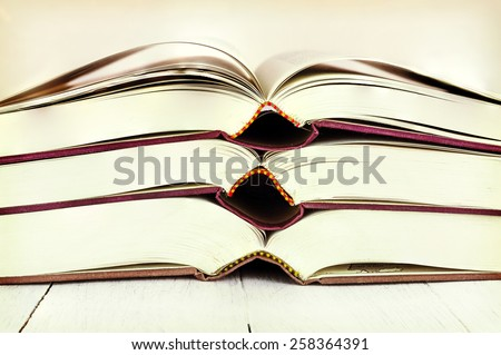Old books on wooden  table - vintage look - stock photo