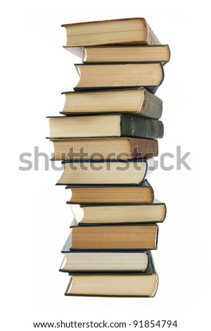 Old books pile isolated on white - stock photo