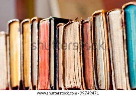 old books row background - stock photo
