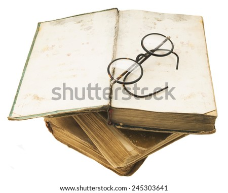Old books with eye glasses isolated on white background - stock photo