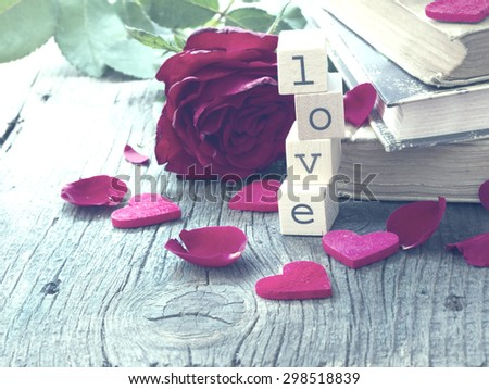old books with red roses, vintage memories - stock photo