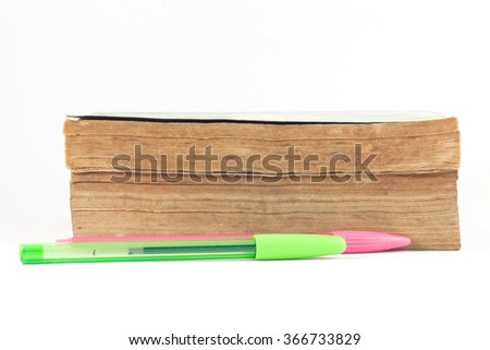 Old books with some pens on white background. - stock photo