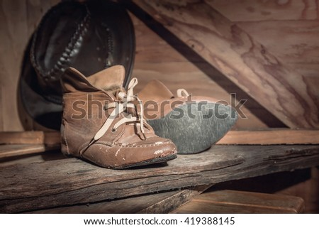 Old boots in the barn,Vintage filters - stock photo