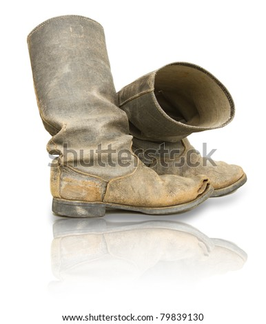 Old boots isolated on white - stock photo
