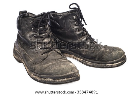 Old Boots, isolated on white background. - stock photo