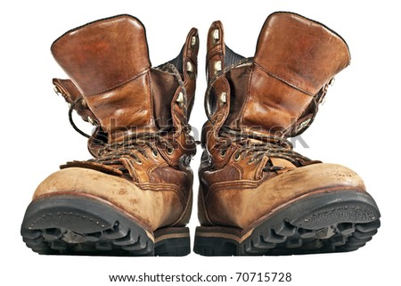 Old boots of brown color isolated on a white background. The photo of the footwear which have been removed in studio 4 - stock photo