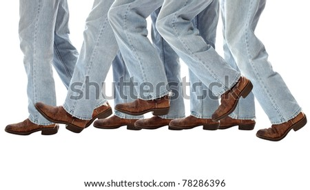 Old boots walking one step forward - stock photo