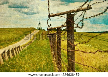 old border with barbed wire - stock photo