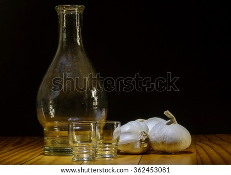 Old bottle with garlic