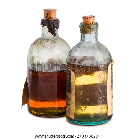 Old bottles with transparent liquid isolated over white background - stock photo
