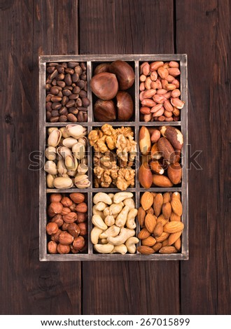 Old box of variety nuts top view - stock photo