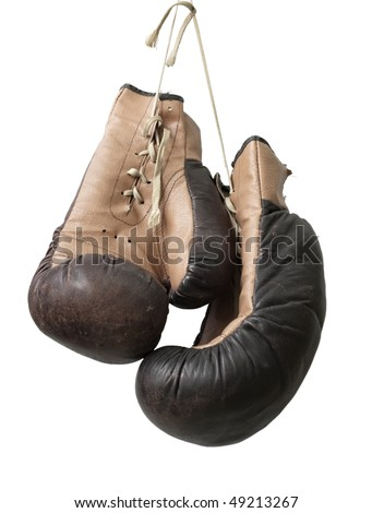 Old boxing gloves hanging on a lace. - stock photo