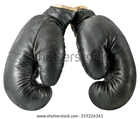 old boxing gloves isolated on a white background