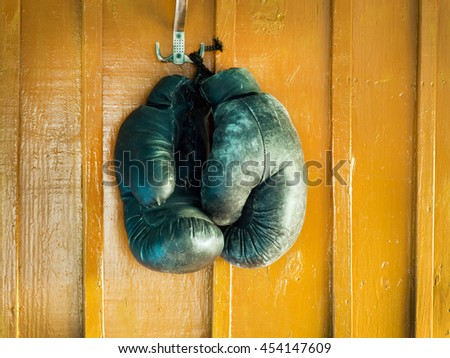 old boxing gloves on a wall - stock photo