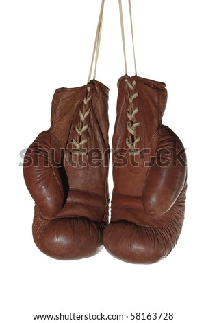 old boxing gloves on white background - stock photo