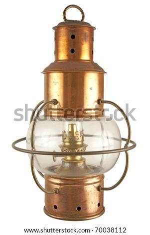 Old brass lantern with petroleum light - stock photo