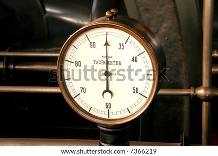 Old brass tachometer or rev counter. Industrial detail.