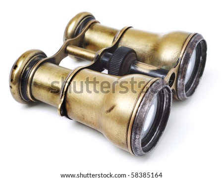 Old brazen binoculars on white background - stock photo