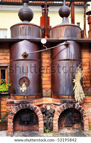 Old brewery - workshop with black steel vats - stock photo