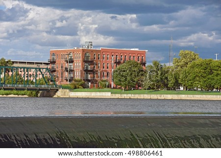 old brick apartment building on the Grand River in Grand Rapids Michigan