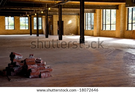 Old brick building is under renovation for modern office spaces. Downtown Toronto. - stock photo