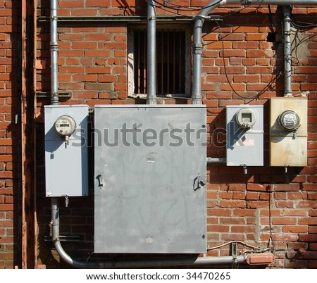 old brick building with electrical boxes - stock photo