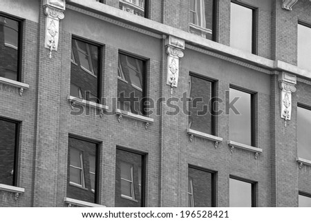 Old Brick Building with windows in black & white