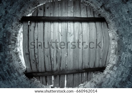 Old Brick Cellar With Round Wooden Door Of The Hatch, Inside View. Toned