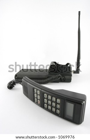 Old 'brick' Cellphone with handset off the hook. - stock photo