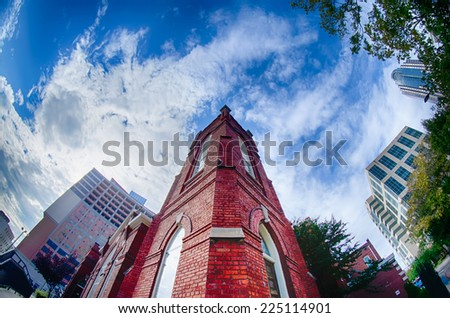 old brick church abuilding in a city - stock photo