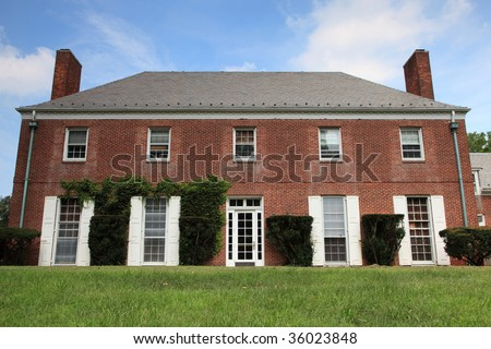 Old brick country english mansion - stock photo